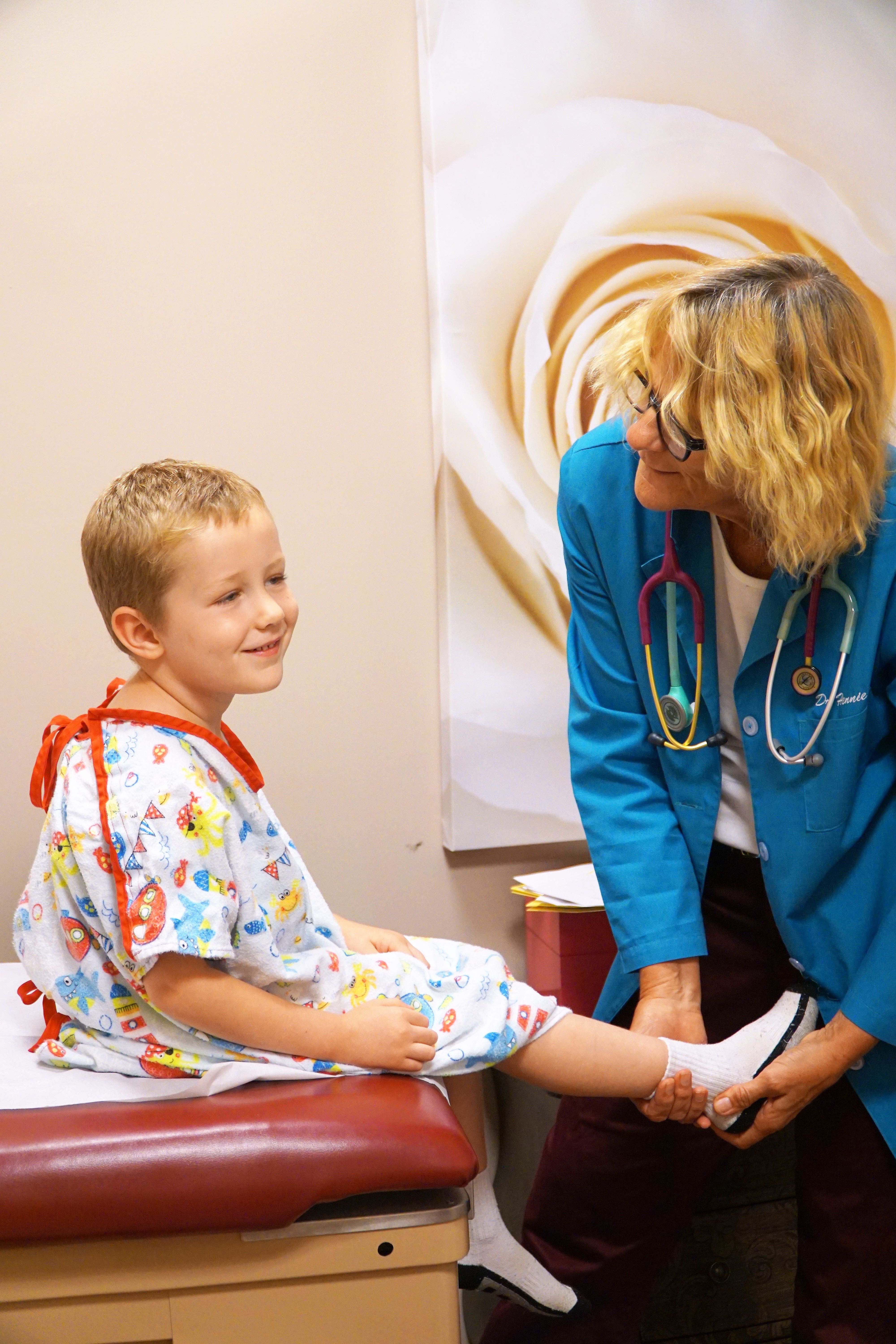 Dr Hennie with a pediatric patient