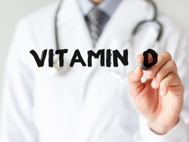 Doctor-writing-word-Vitamin-D