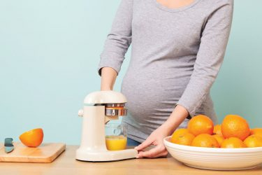 Expecting mother makes natural orange juice